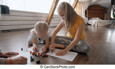 Blonde teaches her children to draw beautiful landscape....