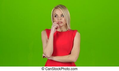 Blonde thought about question and found answer. Green screen...