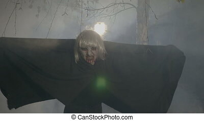 Blonde vampire uncovering his mantle and preparing to attack...