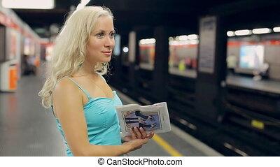 Blonde waiting train at the metro station in Milan