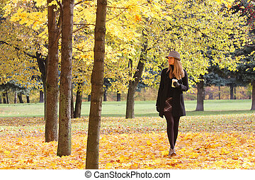 Blonde walking in park