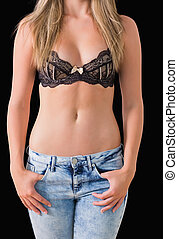 Blonde wearing jeans and bra