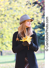 Blonde with autumn leaves