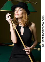 blonde with cue - Portrait of the beautiful blonde woman ...