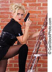 blonde with gun