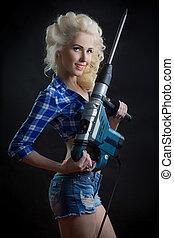 blonde with industrial hammer. dark background.