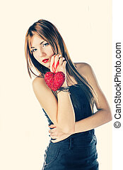 Blonde with red heart in her hands