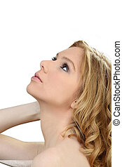blonde with ringlets looking upwards