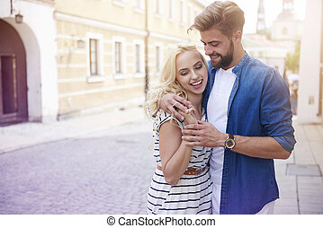 Blonde woman and man on the city street