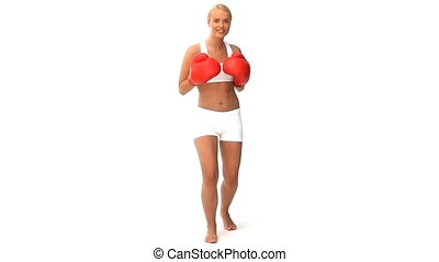 Blonde woman boxing - Blond ewoman boxing isolated on a...