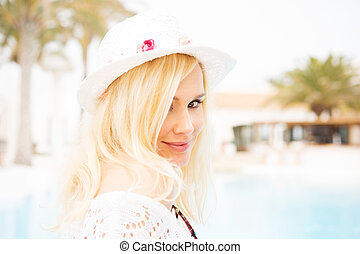blonde woman by the pool