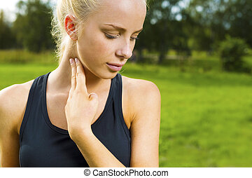 Blonde woman checks her pulse after a long run - Young...