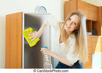 Blonde woman cleaning glass