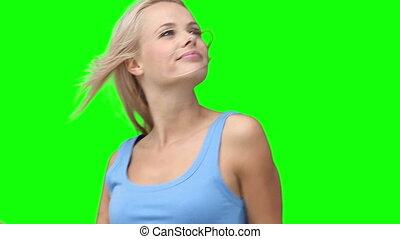 Blonde woman dancing energetically