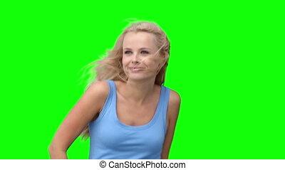 Blonde woman dancing to music