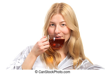 Blonde woman drinking a cup of tea