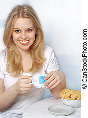 Blonde woman drinking coffee