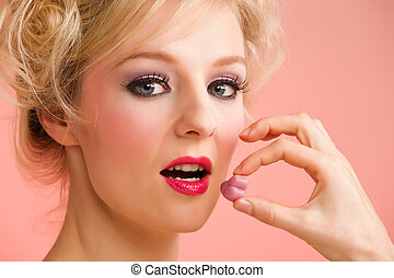 blonde woman eating sweets
