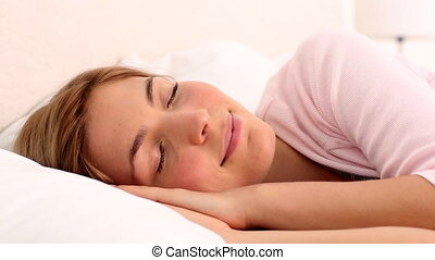 Blonde woman enjoying her sleep