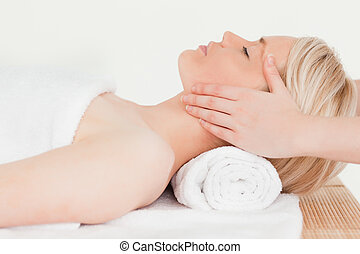 Blonde woman enjoying her treatment in a Spa centre
