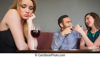 Blonde woman feeling envious of two people are flirting...