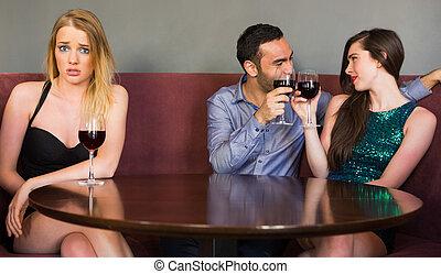 Blonde woman feeling jealous as two people are flirting...