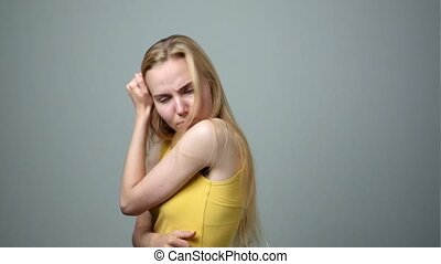 Blonde woman feels badly having problem and difficulties. Negative emotions facial expression.