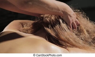 Blonde woman getting head massage in spa. eastern medicine...