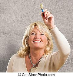 Blonde Woman Holding Paint Brush