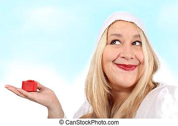 Blonde woman holding present