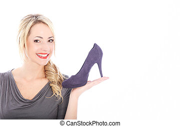 Blonde Woman Holding Purple High Heel - Smiling young blonde...