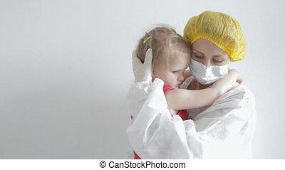 Blonde woman hugs little girl