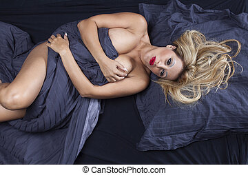 blonde woman in a bed