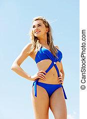 Blonde woman in a blue swimsuit