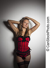 blonde woman in a corset