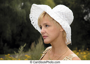 blonde woman in a white hat