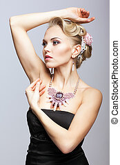 Blonde woman in black dress and necklace - Young blonde...