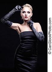 Blonde woman in black dress