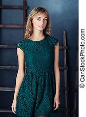 Blonde Woman in Green Dress Posing