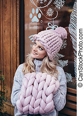 Blonde woman in pink knitted hat
