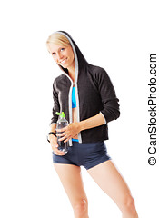 Blonde woman in sports wear holding a water bottle and smiling to the camera