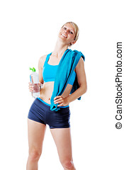 Blonde woman in sports wear satisfied with her performance holding a water bottle and blue towel