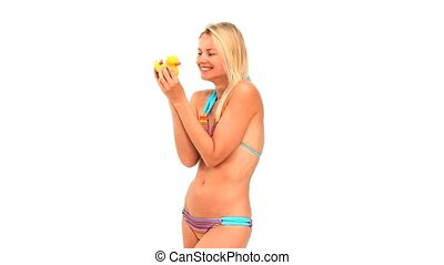 Blonde woman in swimsuit holding a plastic duck isolated on...