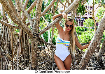 Blonde Woman in white swimsuit Posing at Mangrove Trees