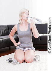 Blonde woman is living at home healthy Living.