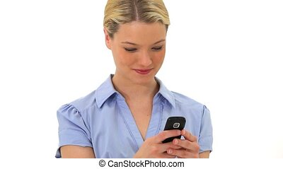 Blonde woman is texting against a white background