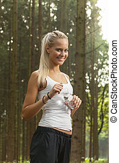 blonde woman jogging with water