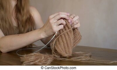 Blonde woman knitting