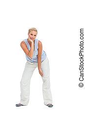 Blonde woman looking at camera and posing