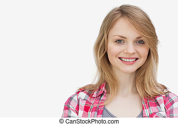 Blonde woman looking at camera while smiling